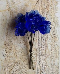 6 vintage cobalt blue glass flowers- probably made in Japan- probably 1950s. These are a more cobalt blue color than depicted in the photo. They havent