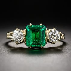 l Antique Emerald and Diamond Ring. A rich luscious green and crystalline old mine square emerald-cut emerald, weighing 1.35 carats, shines shoulder-to-shoulder with a pair of sparkling old mine-cut diamonds, weighing .35 carat each (.70 carats total), in this truly superb and stunning late-nineteenth/early-twentieth century three-stone ring elegantly rendered in 14K yellow gold.