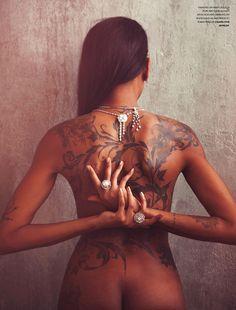 beautiful floral tatoo brown ink on dark skin