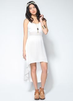 Sleeveless high-low dress featuring cut out lace panel and adjustable straps. Invisible zipper closure at back.  100% Rayon 34 length at front, 48 length at back Model is wearing size S