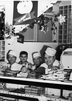 Meat counter in La Gloria Food Market during Christmas season, 701 S. Laredo Street, San Antonio, Texas, December 1950