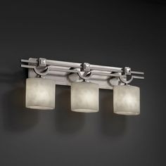 This 3-light bath bar has an amazing argyle design frame with a sleek brushed nickel finish. The fixture has beautiful oval shaped shades with compositions of neutral colors.