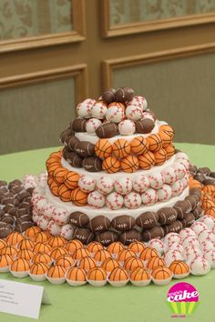 The ultimate sporty grooms cake with cake pop balls surrounding it!