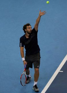 Ernests Gulbis Photos - Ernests Gulbis of Latvia in action against Benjamin Becker of Germany during the Malaysian Open at Putra Stadium on September 2014 in Kuala Lumpur, Malaysia. Benjamin Becker, Basketball Court, Photos