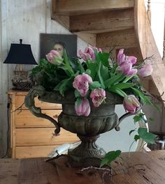 This is one of my very favorite arrangements.....love the urn, love the flowers....and they could be white or any color to match decor...love it!!!  This says:  Vintage urn, pink tulips