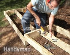 A wooden walkway makes an attractive and inexpensive garden path, is simpler and less backbreaking to make than a stone or concrete path, and works well in sloping or wet areas. Wood Pathway, Wooden Path, Concrete Path, Wooden Walkways, Backyard Walkway, Outdoor Walkway, Garden Stairs, Backyard Landscaping, Walkway Ideas