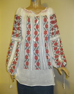 Stunning hand made Romanian peasant blouse, hand embroidered with red and black cotton thread on white very fine gauze cotton. Beautiful detailed with silk hand embroidery. Embroidered on the finest and sheer white gauze cotton.  Available at www.greatblouses.com Peasant Blouse, Knit Fashion, Red Blouses, Cotton Thread, Beautiful Hands, Black Cotton, Hand Embroidery, Bell Sleeve Top, Traditional