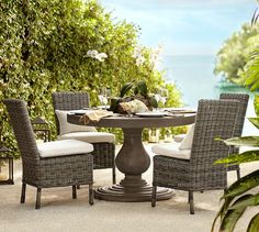 Geneva Concrete Round Dining Table & Huntington Dining Chair Set | Pottery Barn
