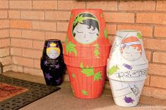 Go a little wild with a paint brush to transform average terra cotta pots into ghoulish door greeters!