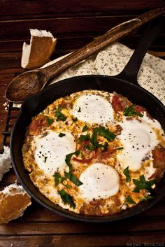 Shakshouka is a North African and Middle Eastern dish. Simple to make: eggs, a couple of ripe tomatoes, onion, garlic, herbs and spices / Recipe