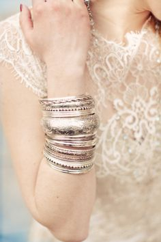 Silver Bangles Bridal Jewelry | photography by http://shootinlove.com/