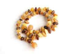 Raw Baltic amber baby teething necklace. Multicolored amber beads $13.99 USD
