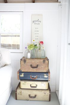 Stack a few vintage suitcases for style and an extra element of dimension. To make this she-shed even more feminine, try adding fresh, colorful flowers in a variety of glass jars for a fresh, serene getaway.
