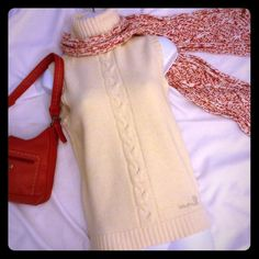 """Hello Kitty Ivory Sleeveless Turtleneck Very good condition. Hello Kitty is embroidered on the lower left of the sweater. It is 22"""" long from the shoulder. It is a wool blend. Hello Kitty Sweaters Cowl & Turtlenecks"""