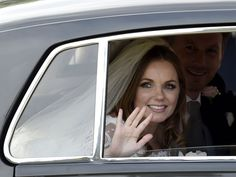 Former Spice Girl Geri Halliwell leaves with her husband, Christian Horner, Red Bull Formula One team principal, after their wedding at St. Mary's Church at Woburn, England.  Toby Melville, Reuters
