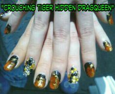 Photo sez it all. :-) basically tiger colors sponged with gold\bronze tiger stripeesque design. Ring fingers just covered in color coordinated stones.