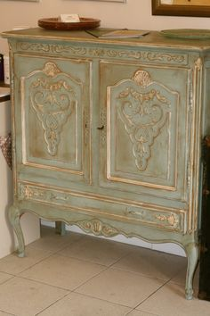 AS Chalk Paint . Duck Egg Blue with Old White accents, then clear wax and some darker wax.