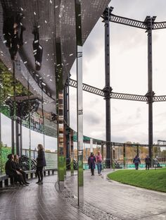Gasholder Park by Bell Phillips has a circular law and polished steel pavilion.