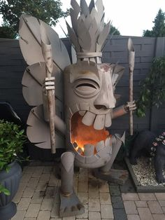 Amazing fabricated Tiki God backyard fire place.