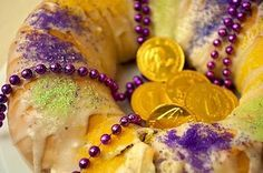 The shape of a King Cake symbolizes the unity of faiths. Each cake is decorated in the traditional Mardi Gras colors: purple represents justice, green represents faith and gold represents power. A small baby, symbolizing the baby Jesus, is baked into each cake.