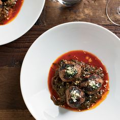 Beef-Ricotta Meatballs with Braised Beet Greens - The secret to these luscious meatballs is using ground beef that has a fairly high fat content and mixing it with fresh ricotta, milk-soaked bread and aromatic seasonings like fennel and lemon zest.  http://www.foodandwine.com/recipes/beef-ricotta-meatballs-braised-beet-greens