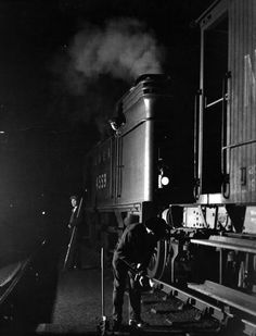 1940: Workers in the marshalling yard of the London and North Eastern Railway during the blackout. (Photo by Hulton Archive/Getty Images)