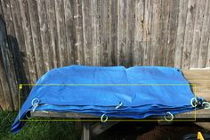 tarp with shower rings attached.JPG