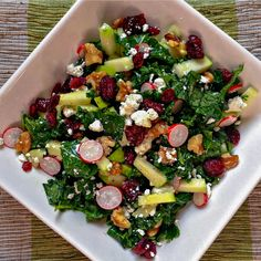 Kale and Apple Salad, with Cranberries,Walnuts and Crumbled Goats Cheese. Fresh, colorful and delicious!