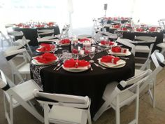 "Black 108"" Rounds, Red Napkins and Silver napkin rings, Black and White Spandex chair sashes doubled up in a tuxedo fashion. All from Linen Tablecloth"