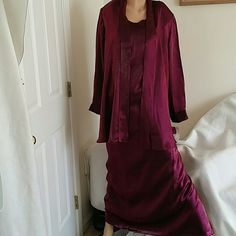 Burgundy 2pc maxi shimmer dress with swing jacket Rich burgundy shimmer maxi dress with rear zip and split has a matching swing jacket. It's light weight and sassy. No stretch. Brought for a wedding once but never wore. It has never been worn and is brand new. NWT. Special occasions dress. Delta Burke  Dresses Prom