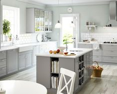 White appliances, white counters, light grey cabinets http://www.houzz.com/photos/22432174/2015-SEKTION-Kitchens-traditional-kitchen-other-metro
