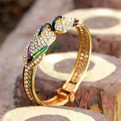 Stone studded peacocks on either side of the bangle what a glittering beauty !!! $6