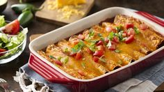 Try these quick cheesy chicken and bean enchiladas, complete with enchilada sauce and mild chiles.