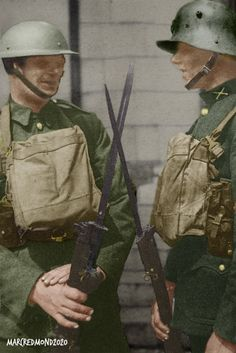 Very old photo, in poor condition. 2 Irish Soldiers on Guard outside an Army camp  in the late 1930s. Both are in the same Army, and both wearing actual service uniforms of the time.  Soldier on the right, is wearing the Irish Free State Army uniform, adopted, with its' German style helmet (Made by Vickers in England), in the late 1920s. The Soldier on the left, is wearing the new uniform and helmet, adopted shortly before the outbreak of WW2. Irish Free State, Army Uniform, Old Photos, Vintage Black, Soldiers, Ww2, 1930s, The Outsiders, Captain Hat