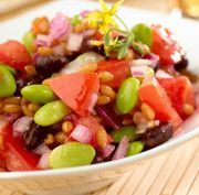 Black Bean, Edamame, and Wheat Berry Salad 4 cups water 1/2 cup dry wheat berries 1/2 of a 15-ounce can of black beans, rinsed and drained 1 cup frozen, shelled edamame, thawed 1 cup chopped tomato 1/2 cup finely chopped red onion 2 Tbsp. Pompeian Red Wine Vinegar 3 Tbsp. Pompeian OlivExtra Plus Fresh Parsley Salt and black pepper to taste