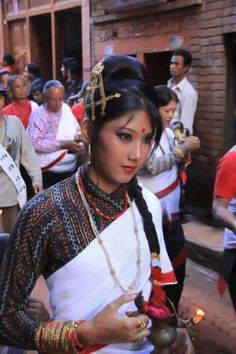 Nepalese: Traditionaly dressed Nepali Girl, Nepal (except for the attire, looks like Dhara...0