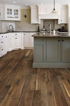 Like the wall color, island same color as dining room walls, lighter cabinets with dark handles, love the wood color for floor; also like browns for backsplash