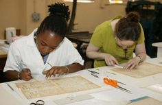 Midwest Art Conservation Center paper conservators treating historic documents
