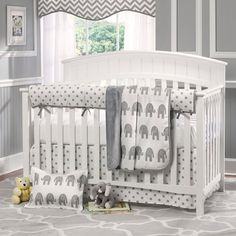 Cute elephant themed nursery. Love the grey walls with the white borders looks really nice. It's a small room but looks great.