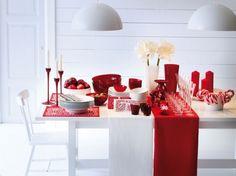 Mesa decorada en rojo y blanco, con elementos de Ikea