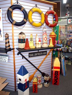 Nautical decorative display. Lovin' the old buoy look!