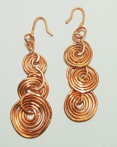 100% hammered handmade and coiled solid copper earrings. Good energy and healing! Handmade ear hooks and approximately 2.5 inches long/6.5 cm.