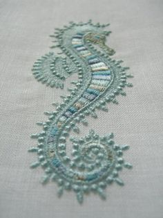 seahorse embroidery - could be a sand sculpture on the beach or with stones and branches
