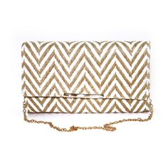 Sondra Roberts Linen Zigzag Pattern Clutch This elegant designer Sondra Roberts Linen Zigzag Pattern Clutch is a must-have! Available in coral color, white and black zigzag patterns. $78.00