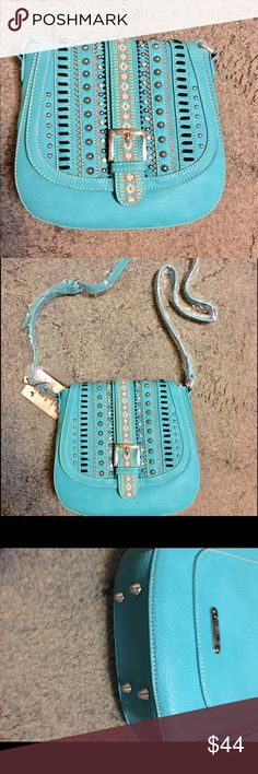 Turquoise cross body handbag 👜 cowgirl Cowgirl crossbody concealed weapon handbag back zip   All the pockets inside and out. With long adjustable strap snap front. By. Montana west fake leather montana west  Bags Crossbody Bags