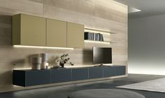 Self suspended drawers in mat grigio ardesia glass, suspended units with fl ap door in mat giallo kashmir lacquered glass.