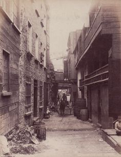 An albumen print showing a run down backstreet in a poor quarter of Quebec City. Photographed by William Notman of Montreal, date unknown. Though in Canada, the image has the same features as 19th century London streets in poor quarters: narrow alleys, flammable wooden structures mixed with stone, and considerable amounts of debris. Via Paul Flecker Nineteenth Century Photography.