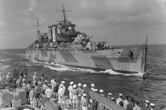 HMS Devonshire coming alongside HMS Mauritius in he Indian Ocean to pass the mail. October 1942. Photo: Lt. H. A. Mason. Imperial War Museums A 13456