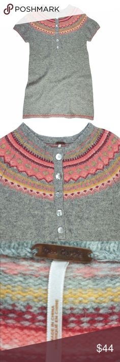"""FREE PEOPLE Gray Lambswool Fair Isle Sweater Dress Excellent condition! This gray and pink fair isle sweater dress from Free People features a pullover style, button closures at the neckline and is unlined. Made of 100% Lambswool. Measures: bust: 34"""", total length: 33"""", sleeves: 7"""" Free People Dresses"""