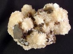 Species    Strontianite ((SrCO3) is an important raw material for the extraction of strontium. It is a rare carbonate mineral and one of only a few strontium minerals. It is a member of the aragonite group.), on Fluorite  Denton Mine, Hardin County Illinois  Measurement   6.4 X 5 X 4.2cm